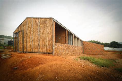 partners in housing sharon davis design uses handmade bricks and eucalyptus to form housing in rwanda