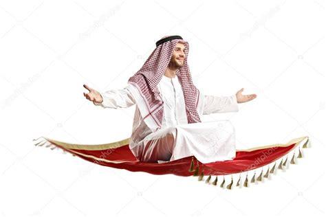 alfombra in arabic pessoa 225 rabe no tapete a voar fotografias de stock