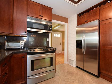 black stainless appliances with cherry cabinets black stainless steel appliances with cherry cabinets