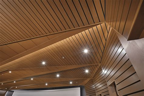 Wood Panels For Walls And Ceilings by Wood Ceilings And Walls Help Convey Energy Of College Football Building Design Construction
