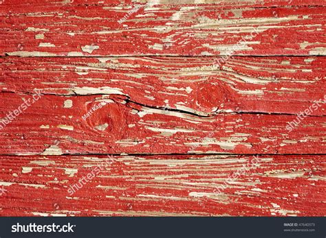 several boards with weathered peeling paint and two knots in the wood form an abstract