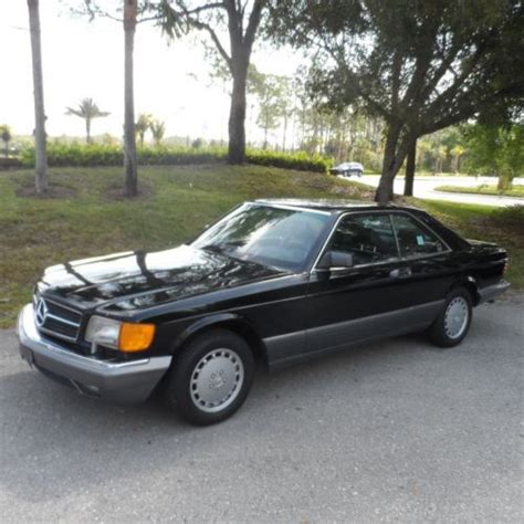 purchase  beautiful black  black mercedes  sec  sunroof  fast  rare