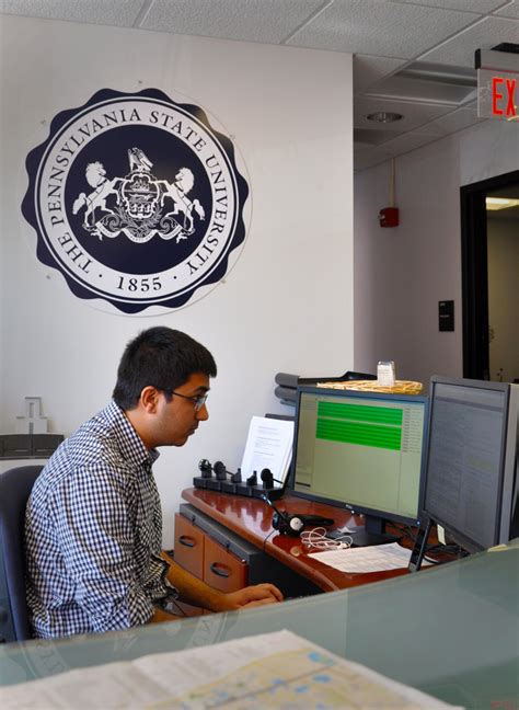 psu it service desk karan kalaria monitors incoming help requests at his desk
