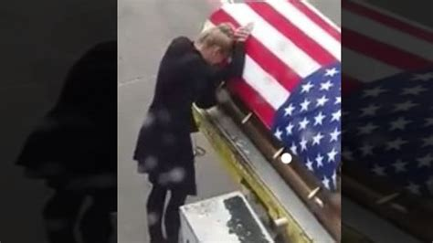 flag draped coffins wife of soldier kisses his flag draped coffin it was