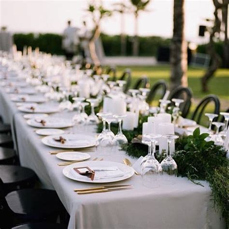 Polished gold cutlery sets and light grey table linens