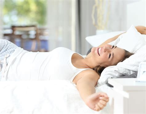 girl in bed mattress care guide extend the life of your mattress