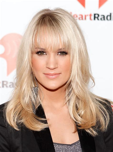 country singer cut hair short carrie underwood long wavy cut with bangs carrie