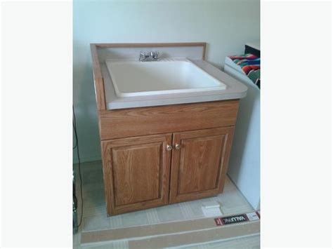 oak finish utility sink laundry tub with cabinet lake