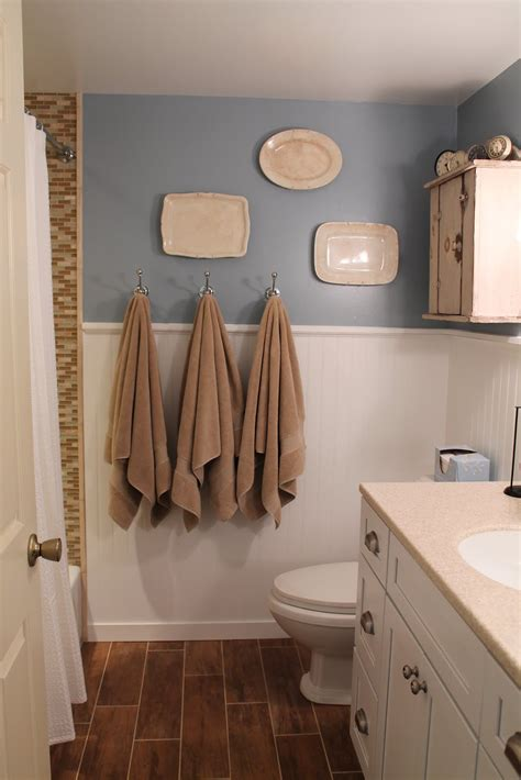 remodelaholic bathroom renovation with wood grain tile