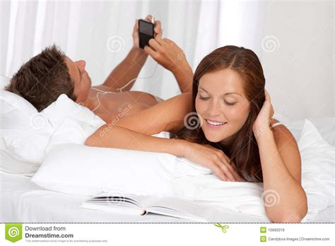 lying down in bed young couple lying down in bed royalty free stock images