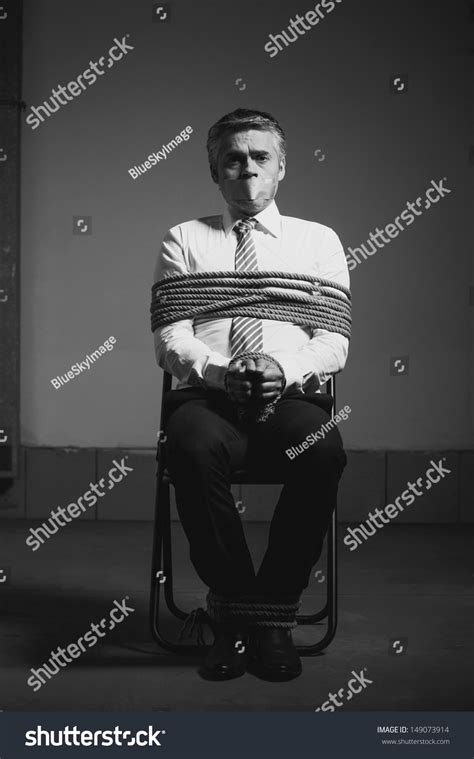 How To Tie A Person To A Chair by Businessman Black White Image Stock Photo