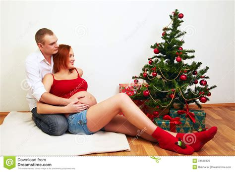 easy christmas gifts for married couples near a tree stock photo image 34588426