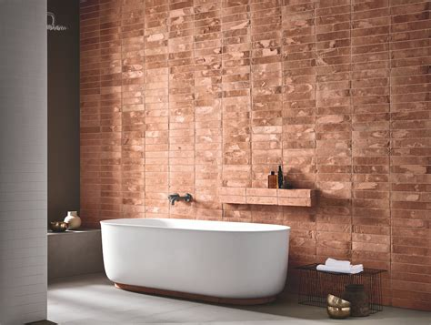 define warm colors clean lines and warm colors define these modern bathroom