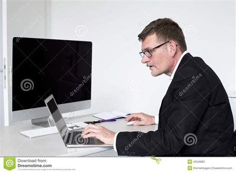 Person Sitting At A Desk by Sitting At Desk Stock Photo Image 42546881