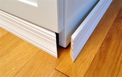 Ikea Toe Kicks Gap On Uneven Floor by Adding Molding To Cabinets To Make Them Look Built In