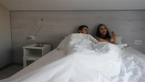 sexuality man and woman in bedroom hotel service female housekeeping worker maid making bed