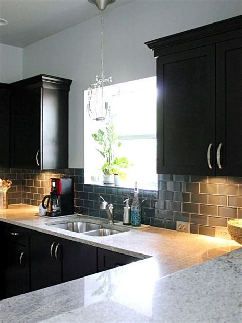 black glass backsplash kitchen glass backsplash and black cabinets kitchens pinterest