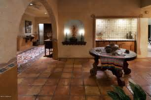 dining room with high ceiling terracotta tile floors in