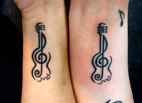 music design tattoo 34 realistic guitar wrist tattoos