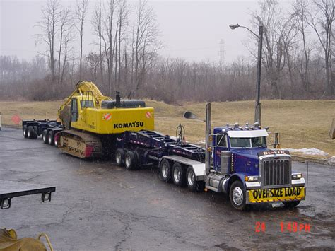 jeep hauling trailer pete triaxle with beam trailer hooked to 2 axle jeep