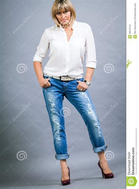 middle age trendy clothing trendy middle aged woman with a charming smile stock photo