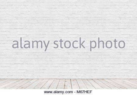 room interior  white brick wall  wood floor background stock photo  alamy