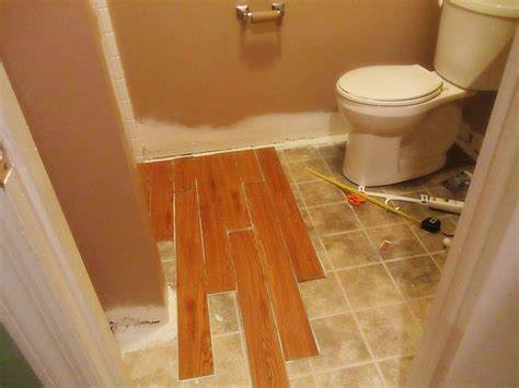 installing linoleum flooring in bathroom installing vinyl wood plank flooring in small spaces bathroom remodel ideas