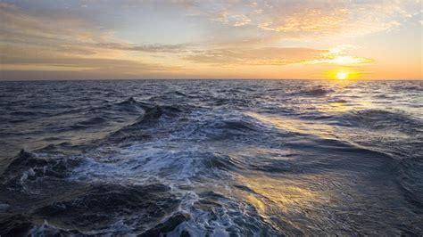 the ocean at the golden sunrise clouds and rising sun above sea atlantic ocean nigel irens design