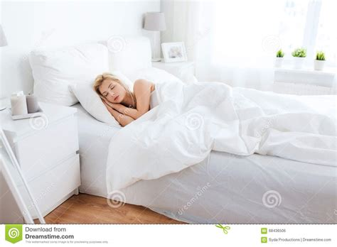 sleeping in bed young woman sleeping in bed at home bedroom stock photo