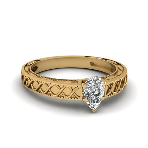 pear shaped engagement ring in 14k yellow gold