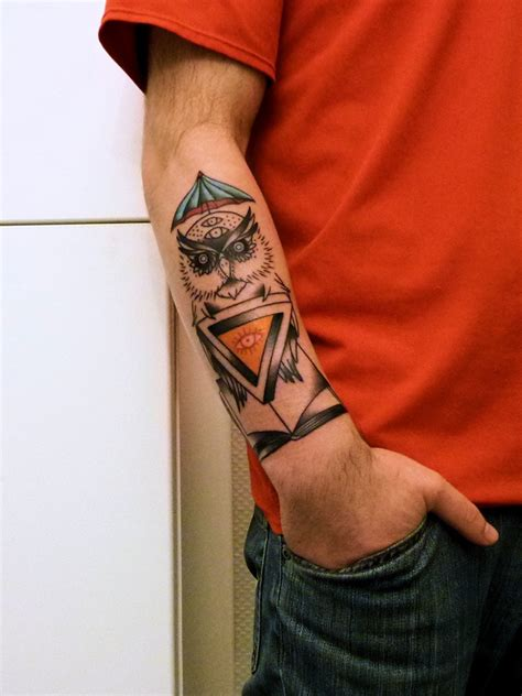 owl tattoo on woman s arm 15 outstanding owl tattoos tattoo me now