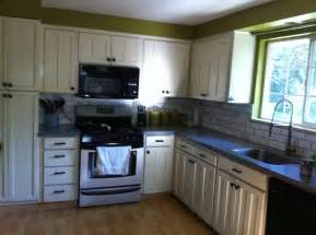 How To Distress Kitchen Cabinets White by Off White Distressed Kitchen Cabinets