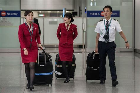 cathay pacific uniforms are says flight