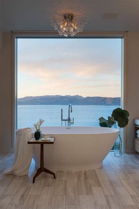 oval bathtub  front  floor  ceiling window
