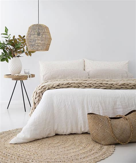 bedroom  white linens  woven basket lighting
