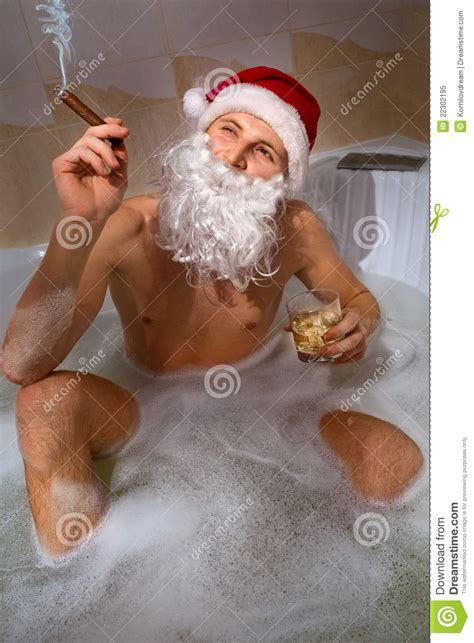 santa in bathtub santa with whisky and cigar sitting in bath tub stock