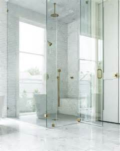 seamless glass shower with brass hinges and brass door