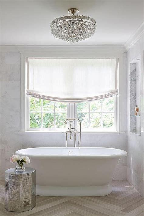 marble niche shelves  tub transitional bathroom