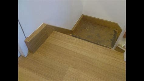 Cladding staircase stringers with Quick Step laminate