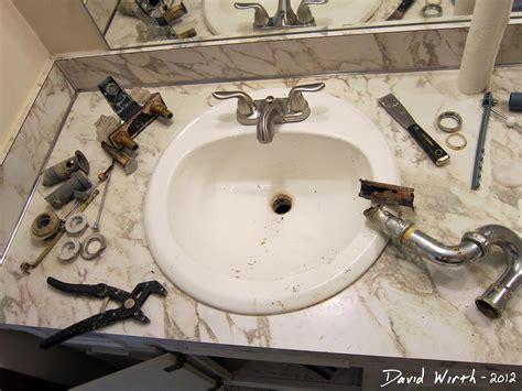 bathroom sink   install  faucet