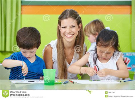 child care worker with children stock photo image 38917287