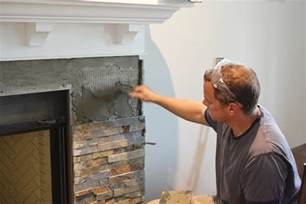 Building our fireplace installing the slate split face tile our