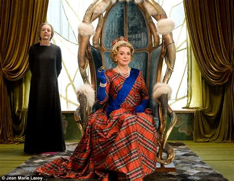 film queen of england looking regal in a crown and tartan french actress