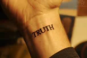 truth lettering tattoo on wrist