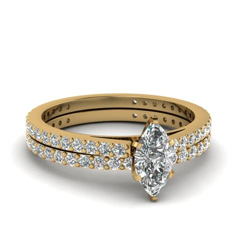 marquise shaped wedding ring set in 14k yellow