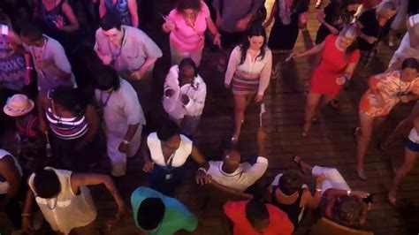 who is black girl dancing on cruise ship commercial thick girl in orange dress dancing walk it by yourself on