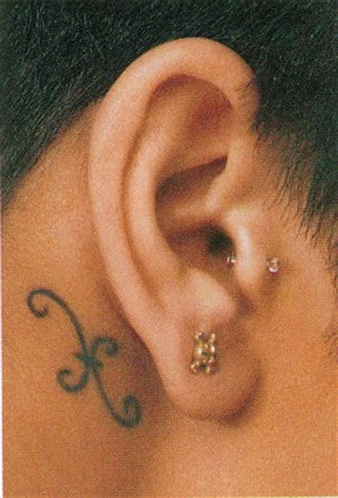 tattoo behind rihanna s ear urban tattoo rihanna roman numeral tattoo