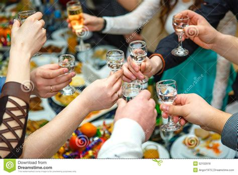 People Hands Clinking Glasses With Vodka And Wine Stock