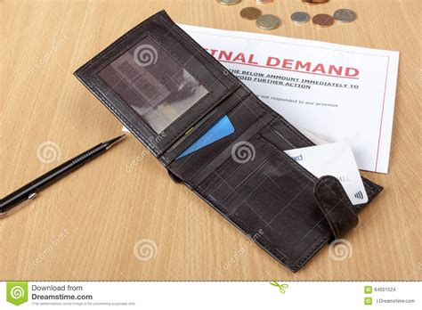 Credit Card Demand Letter demand letter on a desk with a wallet stock photo