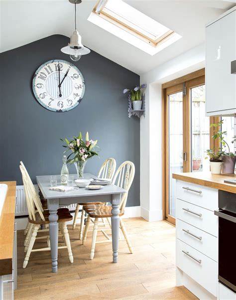 tonal grey kitchen diner with painted farmhouse furniture and roof light design decor